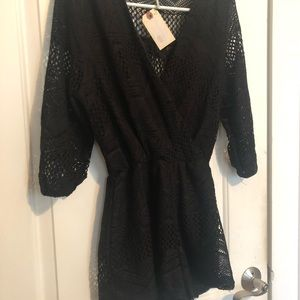 Black crocheted romper from a local Boutique.